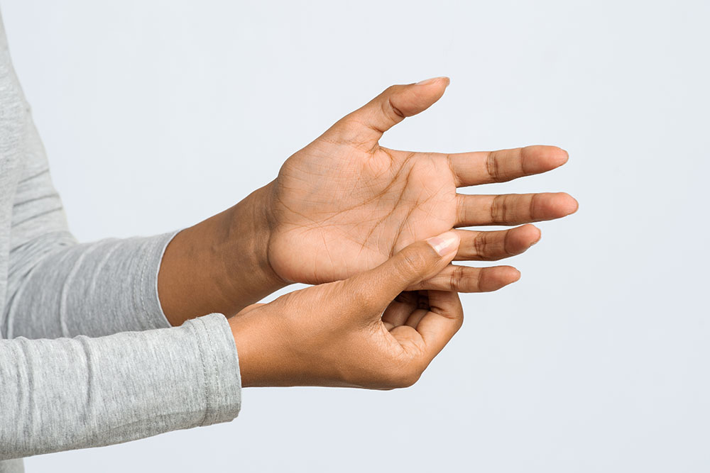 Close up of woman hand with finger pain